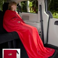 Velura Travel Quillow, travel blanket / pillow in red.