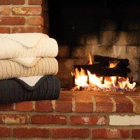 Jeté en laine d'agneau en tricot torsadé
